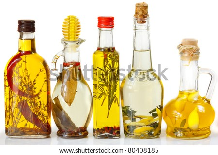Homemade olive oil with spices and herbs. - stock photo