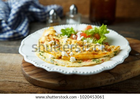 Homemade omelette with tomato, parsley and cheese