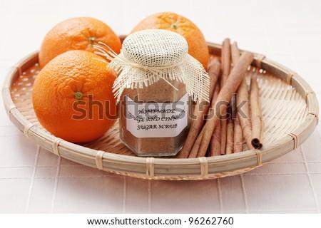 homemade orange and cinnamon sugar scrub - beauty treatment - stock photo