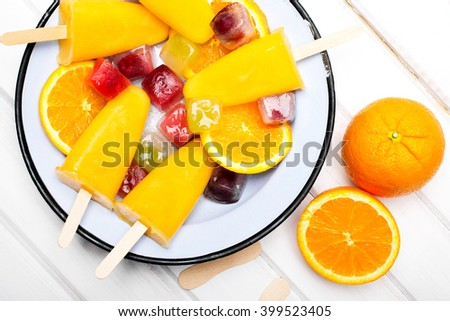 Homemade orange ice cream on a stick - stock photo