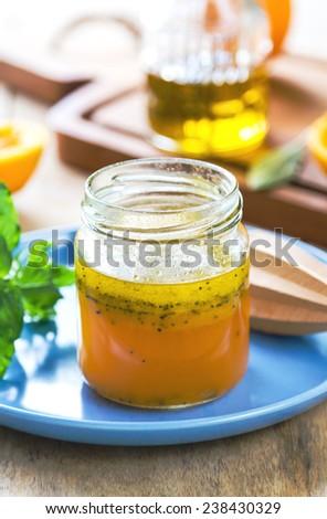 Homemade Orange salad dressing with poppy seed - stock photo