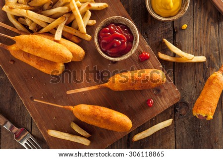 Homemade Organic Corn Dogs with Fries and Ketchup - stock photo