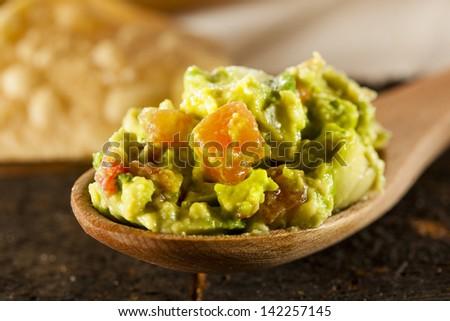 Homemade Organic Guacamole made with avacados and Tortilla Chips - stock photo