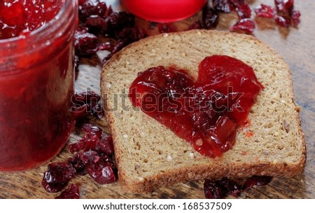 Homemade Organic Jelly on Whole Grain Bread for Valentine's Day - stock photo