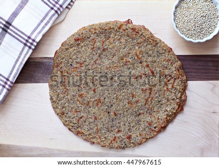 Homemade organic quinoa pizza crust, baked and ready for your toppings.
