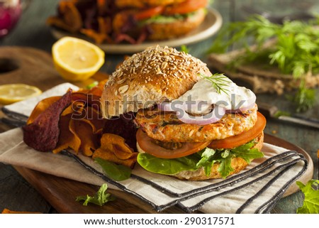 Homemade Organic Salmon Burger with Tartar Sauce - stock photo