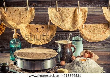 Homemade pancakes production line - stock photo
