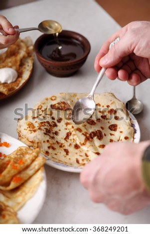 homemade pancakes with various fillings. people eat pancakes. snack for Shrovetide. - stock photo