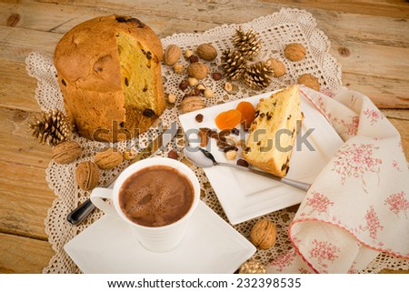 Homemade panettone served with hot chocolate, an Italian classic gone Peruvian - stock photo