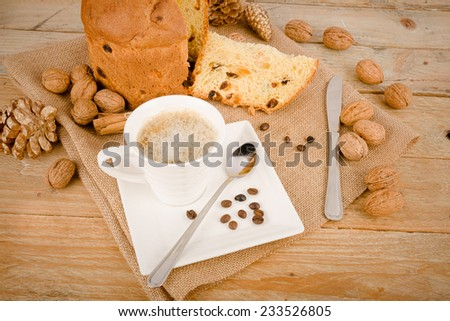 Homemade panettone with a cup of cappuccino and some ingredients - stock photo