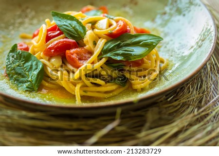 Homemade pasta with Basil and tomatoes. Italian style - stock photo