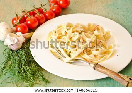 homemade pasta with red fish - stock photo