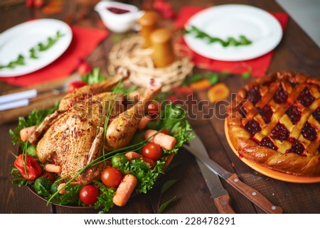 Homemade pastry and roasted poultry on festive table - stock photo