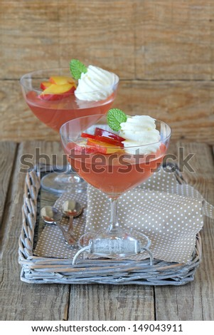 Homemade peach gelatin with fresh peaches and whipped cream - stock photo