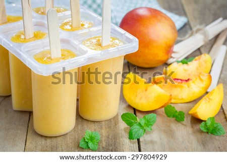 Homemade peach popsicles - stock photo