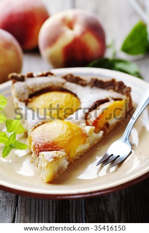 homemade peach tart, made with fresh peaches and almond cream - stock photo