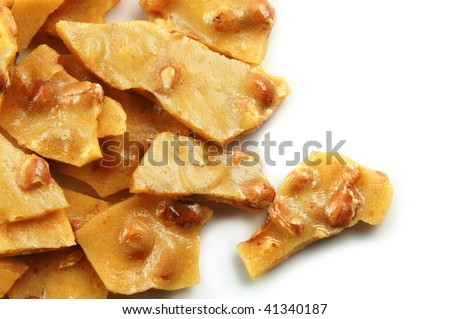 Homemade peanut brittle on a white background - stock photo