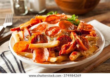 Homemade Pepperoni and Cheese PIzza French Fries with Sauce - stock photo