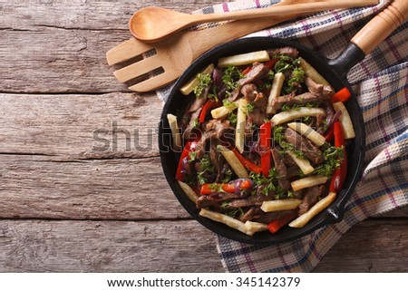 Homemade Peruvian Food: Lomo saltado in a frying pan. horizontal view from above