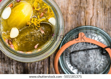 Homemade pickle with garlic and dill. Pickled gherkins in glass jar, overhead