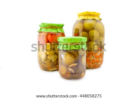 Homemade pickled green and red tomatoes with cucumbers, carrots and ...