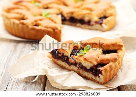 Homemade pie on grey wooden background - stock photo