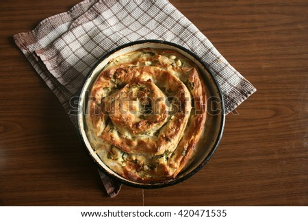 Homemade pie with cheese and chard - stock photo