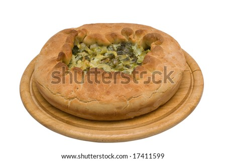 Homemade pie with onion on wooden plate. Isolated on white background