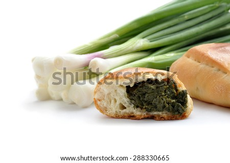 Homemade pies with green onion and cheese on white background - stock photo