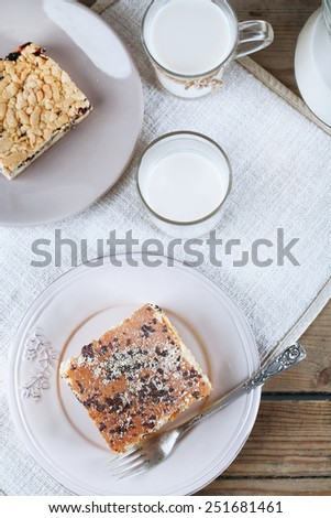 Homemade pies with jam and glass of milk on wooden planks background - stock photo