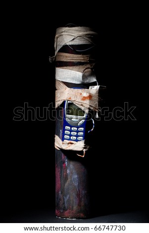 Homemade pipe bomb on a black background - stock photo