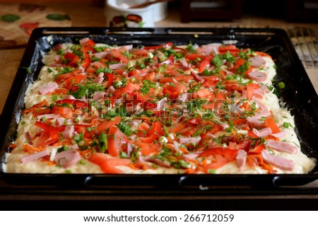 Homemade pizza, made on homemade recipes, pizza with delicious fillings - stock photo