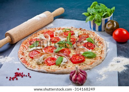 Homemade pizza. The dough with the addition of fiber and Provencal herbs - stock photo