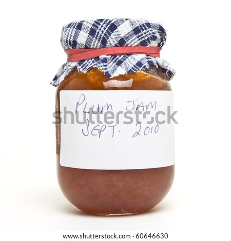 Homemade plum jam from low perspective isolated on white. - stock photo