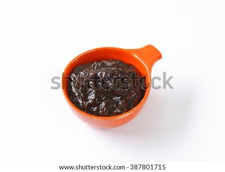 Homemade plum jam in a bowl - stock photo