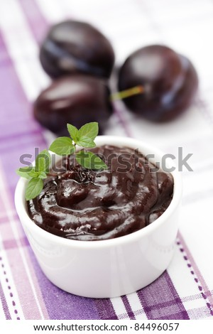 homemade plum jam with fresh plums - goods in jar - stock photo