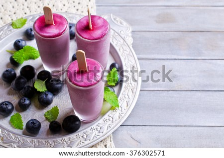 Homemade popsicle blueberry and cream. Selective focus. - stock photo