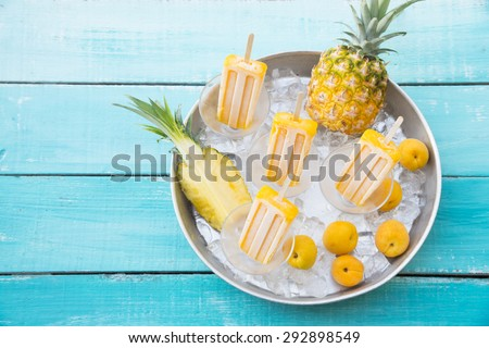 Homemade popsicles made with apricot and pineapple - stock photo