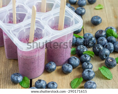 Homemade popsicles with blueberry, yogurt and honey - stock photo