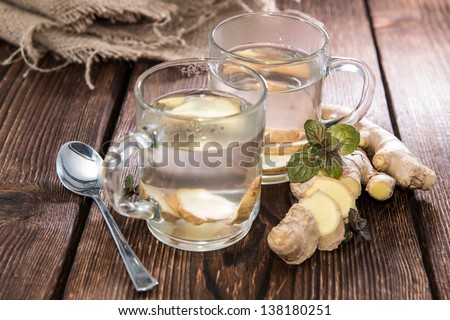Homemade portion of fresh Ginger Tea - stock photo