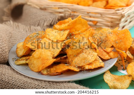 Homemade potato chips, close up - stock photo