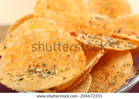 Homemade potato chips in glass bowl, close up - stock photo