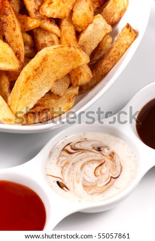 Homemade potato chips with dips - stock photo