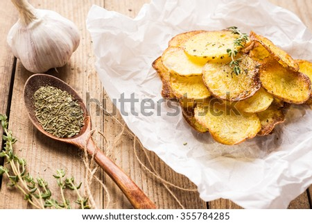 Homemade potato chips with spices - stock photo
