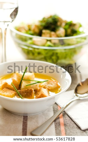 Homemade potato cream soup with green salad - stock photo