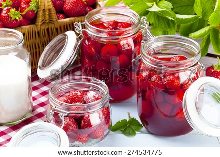 Homemade preserves, prepare compote of strawberries. - stock photo