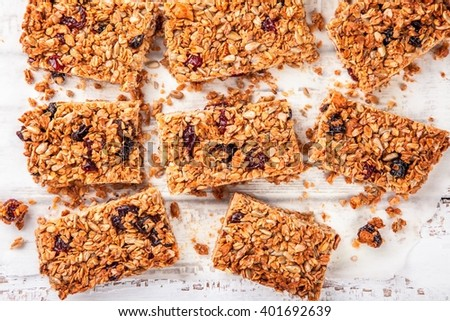 homemade protein granola bars, with nuts, raisins and dried cherries - stock photo