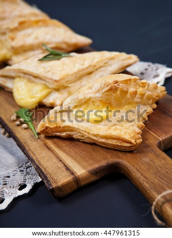 Homemade puff pastry with cheese - stock photo