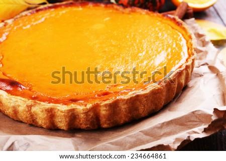 Homemade pumpkin pie on wooden background - stock photo
