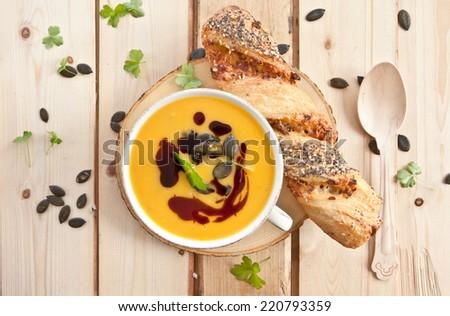 Homemade pumpkin soup with pumpkin seeds and pumpkin seed oil - stock photo